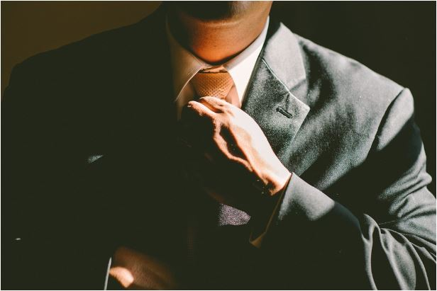 leader fixing his tie